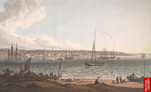 View of a port with sailing ships in the foreground