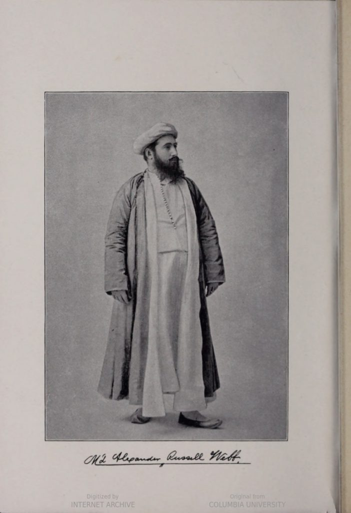 A full figure portrait of Webb wearing traditional Muslim robes.