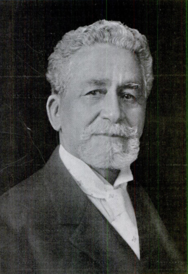 Photograph of Greener as an older man with white or gray hair and a beard.